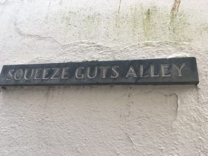 Signage for Squeeze Guts Alley